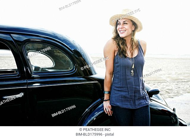Woman standing near vintage car
