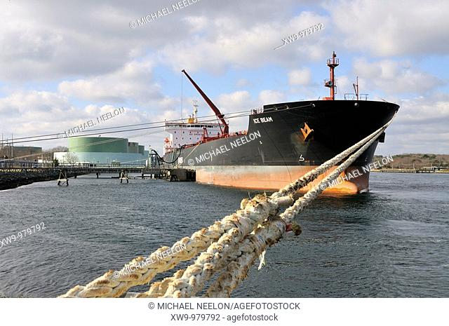 Fuel tanker Ice Beam offloading  oil at marine terminal on the Cape Cod Canal, Sandwich, Massachusetts USA