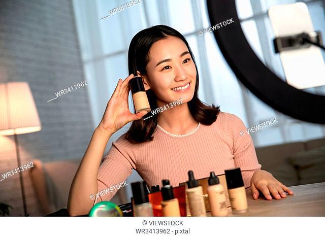 Young women live online makeup