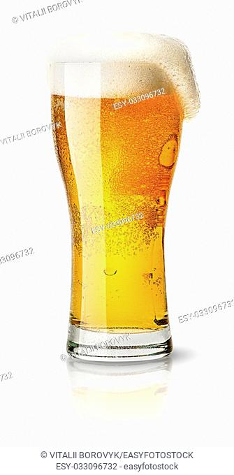 Light beer in sweaty glass and foam isolated on white background