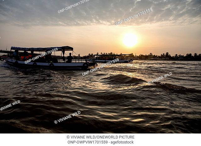 Vietnam, C?n Tho, Can Tho, Motorboat to the floating markets of Cai Be, Mekong Delta, Can Tho. The most famous floating market is Cai Be Floating Market just a...