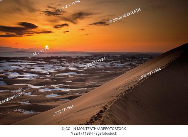 Khongur sand dunes, Sevrei mountains, sunset, winter in Gobi desert, Mongolia