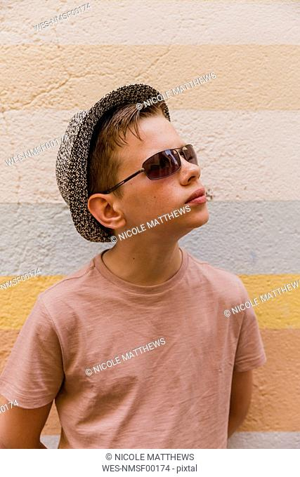 Portrait of boy wearing sunglasses and hat