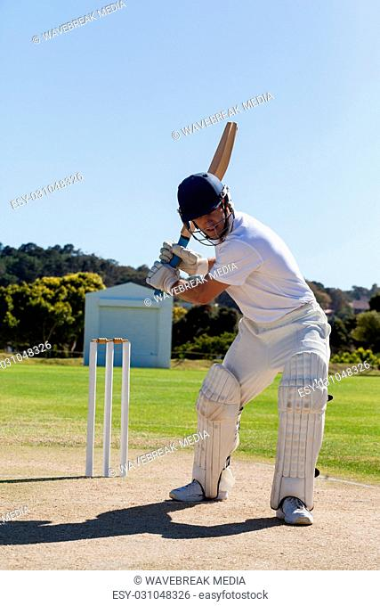 Determined cricketer playing on field