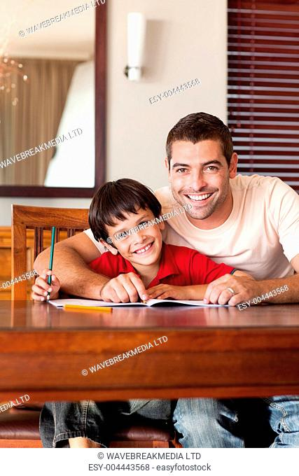 Radiant father helping his son for homework