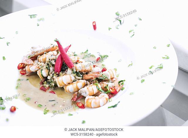 fresh mediterranean prawns in white wine garlic and chilli sauce tapas dish