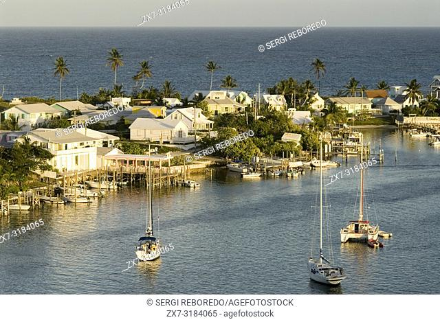Aerial views of the Hope Town, Elbow Cay, Abacos. Bahamas. Lighthouse and harbor in the tiny village of Hope Town