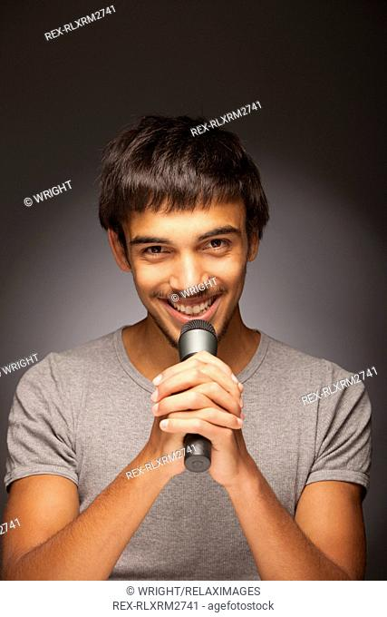 Teenager male singing singer microphone music