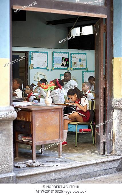 Teacher and school children in classroom, Havana, Cuba