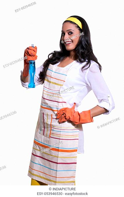 Portrait of a woman with cleaning liquid