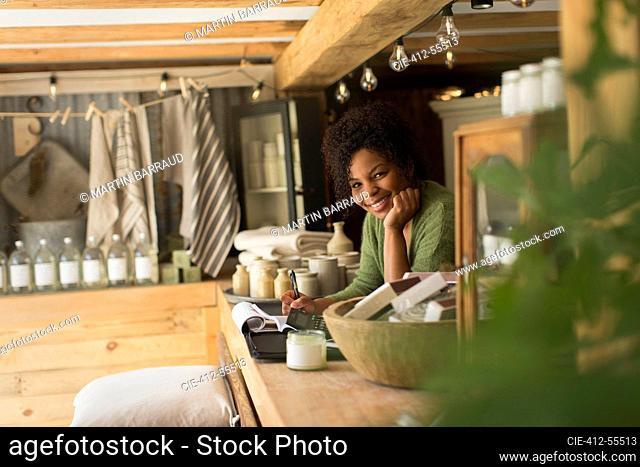 Portrait confident smiling shop owner