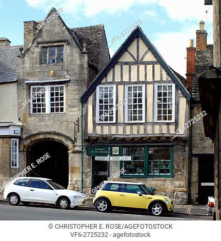 England, Cotswolds, Oxfordshire, Burford, quaint High Street shop fronts, new mini car