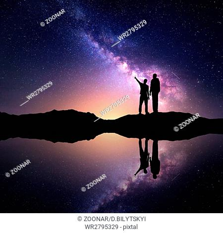 Landscape with Milky Way and men. Silhouette of a people