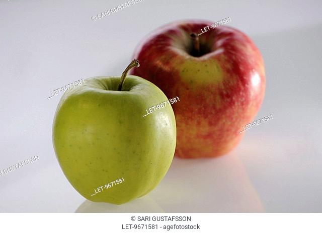 A yellow and a red apple