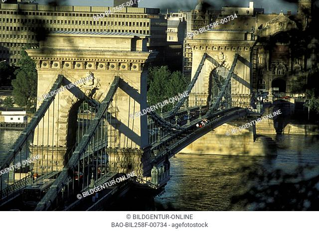 The suspension bridge or Szechenyi Lanc hid on the Danube in Budapest of the capital of Hungary