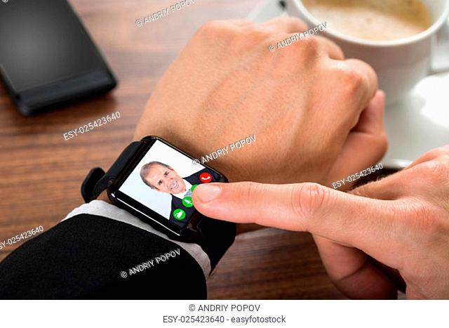 Close-up Of A Businessman Video Calling Using Smartwatch