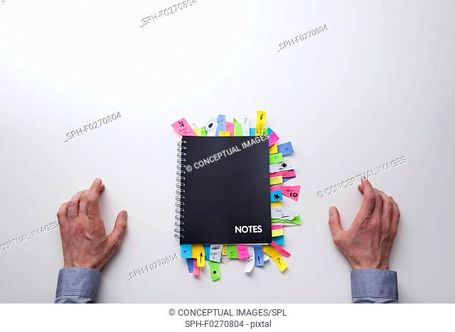 Notepad full of sticky notes