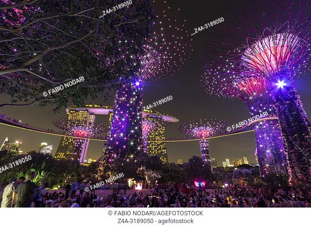 Singapore, Singapore - October 16, 2018: Supetree Grove and Marina Bay Sands at night at the Gardens by the Bay in Singapore
