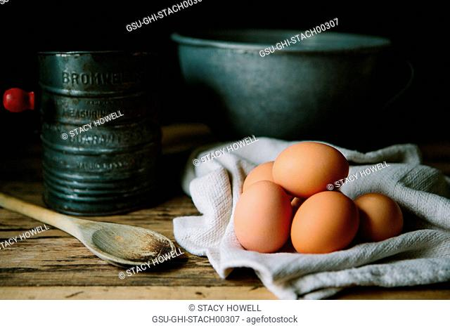 Brown Eggs with Wood Spoon, Sifter and Mixing Bowl