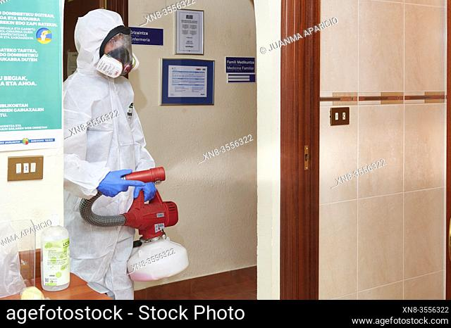 Technician disinfecting medical center with chemical detergents against Covid-19