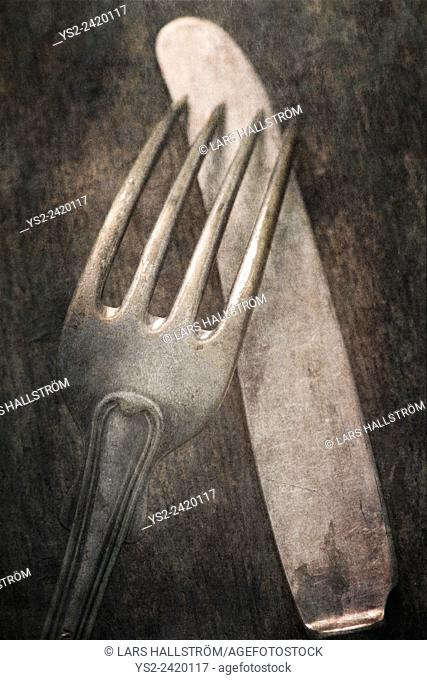 Still life with silverware on table. Knife and fork on a wooden table
