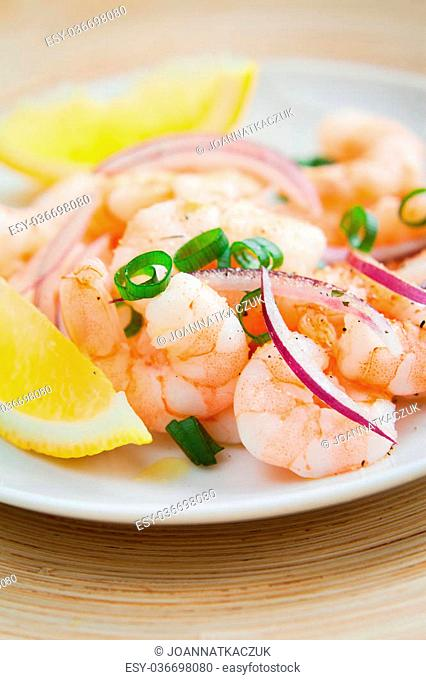 King prawn peruvian ceviche - marinated in lime and lemon juice fresh seafood with red onion and spicy chili