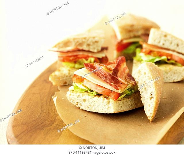BLT sandwiches on grease-proof paper