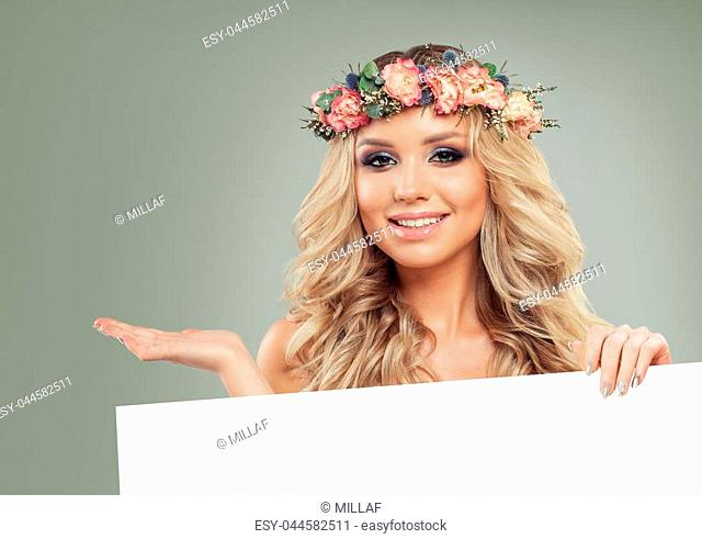 Cheerful Model with Blank Board Banner Background. Beautiful Woman holding White Paper