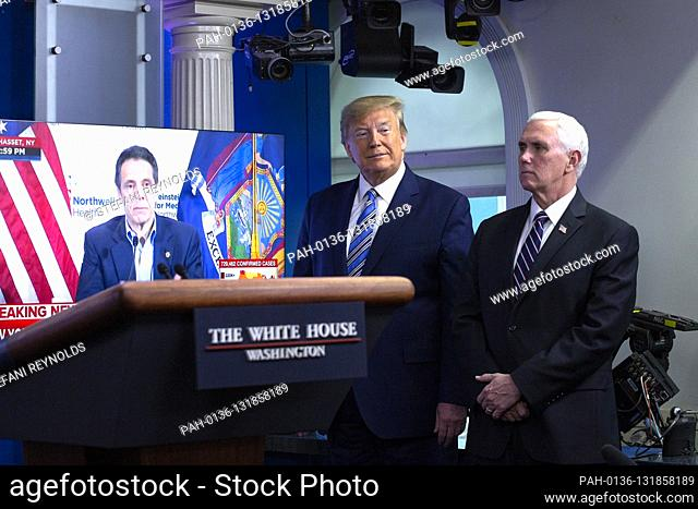 United States President Donald J. Trump, joined by United States Vice President Mike Pence, listen to a video of New York Governor Andrew Cuomo during a news...