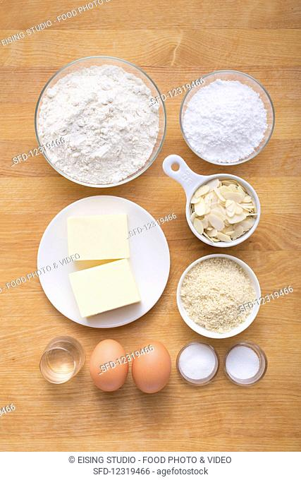 Ingredients for making Sablés (biscuits with almond flakes)