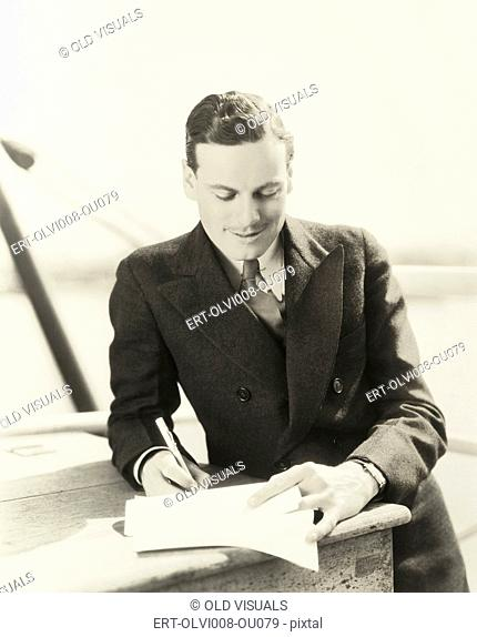 Man signing a contract (OLVI008-OU079-F)