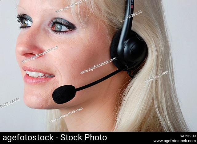Portrait of young woman with headset