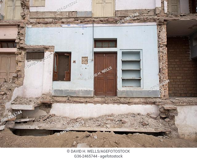 Front of ruined building cut to make way for highway expansion in Sojat, Pali district, Rajasthan, India