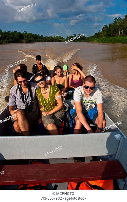 Tourists enjoy safari by boat in the KINABATANGAN RIVER WILDLIFE SANCTUARY which is home to many wildlife species - SABAH, BORNEO - , 06/04/2014