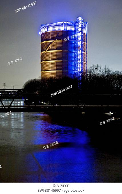 Rhine-Herne-Channel with the spectacular illuminated Gasometer at night, Germany, North Rhine-Westphalia, Ruhr Area, Oberhausen