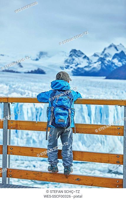 Argentina, Patagonia, Perito Moreno glacier, boy looking at glacier