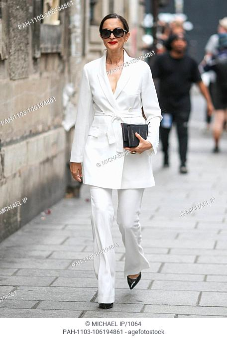 A chic showgoer posing outside of the Givenchy runway show during Haute Couture Fashion Week in Paris - July 1, 2018 - Photo: Runway Manhattan ***For Editorial...