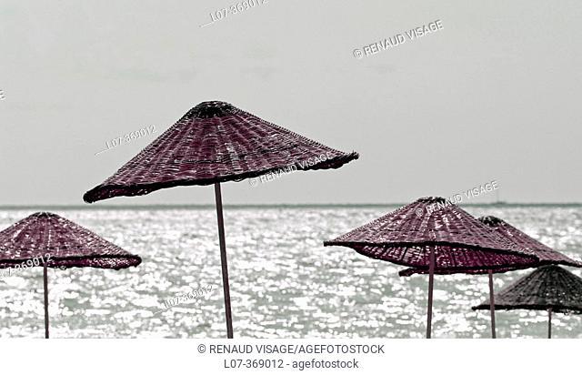 Straw parasols on the beach. Çirali. Turkey
