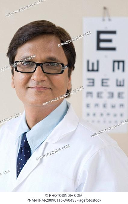 Doctor in front of an eye chart, Gurgaon, Haryana, India