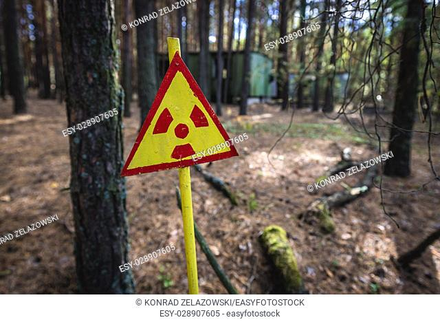Ionizing radiation warning sign in Pripyat city of Chernobyl Nuclear Power Plant Zone of Alienation around the nuclear reactor disaster in Ukraine