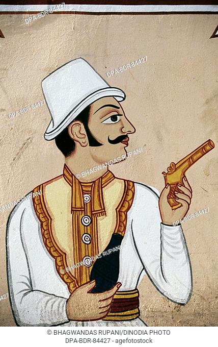 Wall Painting of British Soldier holding Pistol , jaipur , rajasthan , India