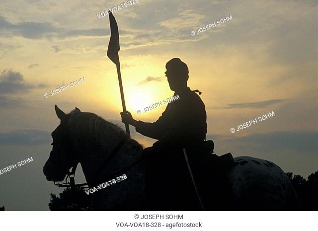 Silhouette of soldier on horseback with gun during reenactment of Battle of Manassas marking the beginning of the Civil War
