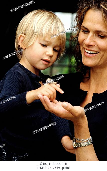 Caucasian mother and son examining snail