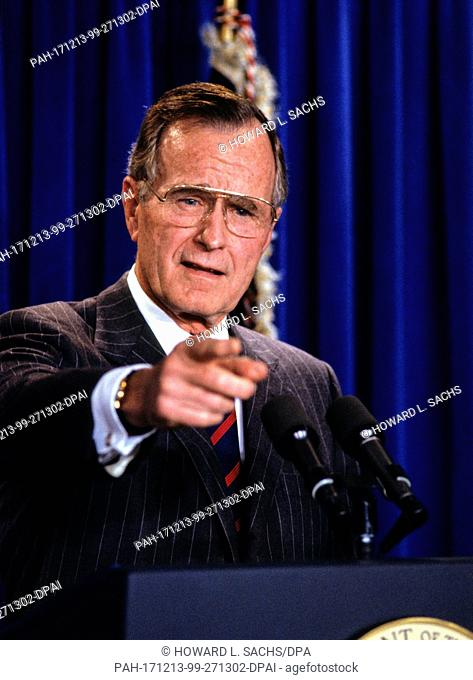 United States President George H.W. Bush speaks to the media in the Press Briefing Room of the White House in Washington, D.C. on December 5, 1991