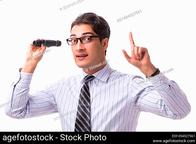 The young handsome businessman looking into future with binoculars