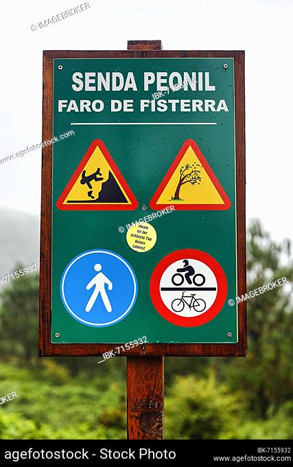 Wooden sign pedestrian way with traffic signs and warnings, endpoint Way of St. James at Cape Finisterre, province A Coruña, Galicia, Spain, Europe