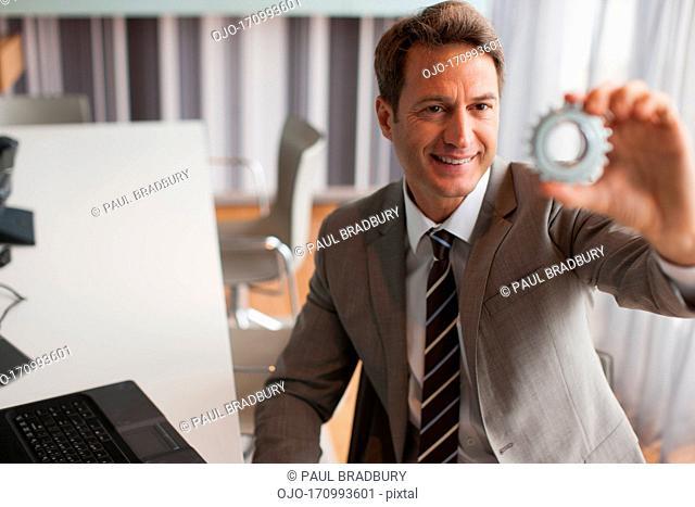 Businessman looking at cog