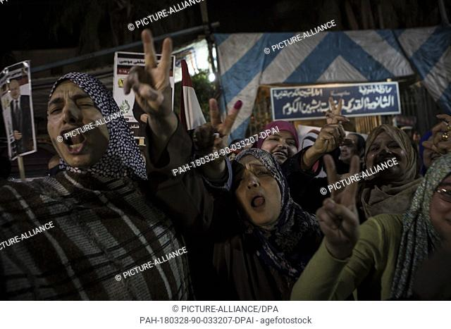 Egyptian women flash the victory sign while ululating after voting on the 3rd day of the 2018 Egyptian presidential elections