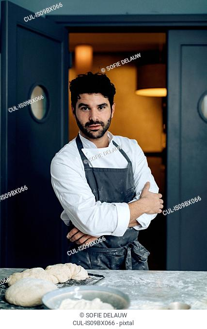 Portrait of chef in kitchen