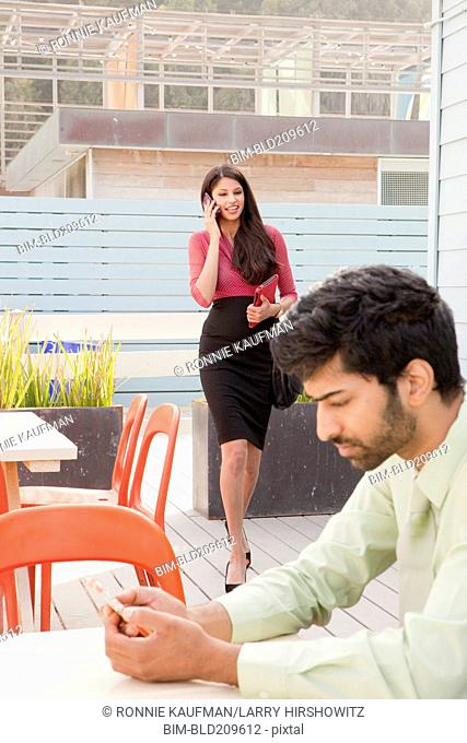 Indian business people on patio